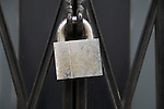 Close up locked strong padlock closed gate made secure
