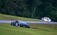 A Ford Mustang leads a Porsche Riley down a hill during the Grand-Am Rolex Series test at Virginia International Raceway, Alton, VA , October 2010. (Photo by Brian Cleary/www.bcpix.com)