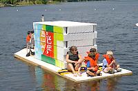 Families riding on floating milk carton houseboat on Lake Calhoun. Aquatennial Beach Bash Minneapolis Minnesota USA