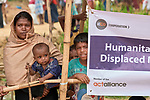 People line up to receive food from ICCO Cooperation in the Chakmarkul Refugee Camp near Cox's Bazar, Bangladesh, where ICCO and other members of the ACT Alliance provide a variety of humanitarian support for Rohingya refugees. <br /> <br /> More than 600,000 Rohingya have fled government-sanctioned violence in Myanmar for safety in Bangladesh.