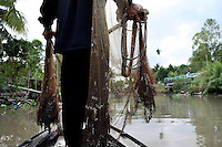 Nguyen Bao Linh is throwing his net from his boat nearby Truong Thanh village, Can Tho province, Mekong delta, Vietnam-2010