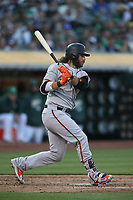OAKLAND, CA - JULY 20:  Brandon Crawford #35 of the San Francisco Giants bats against the Oakland Athletics during the game at the Oakland Coliseum on Friday, July 20, 2018 in Oakland, California. (Photo by Brad Mangin)