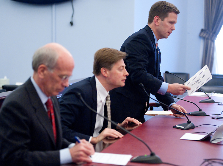 UNITED STATES  MARCH 8: Rep. Robert Dold, R-Ill., right, places his name card on the witness table to join Rep. Jason Altmire, D-Pa., center, and Rep. Peter Welch, D-Vt., for the House Budget Committee's hearing on the FY2013 budget on Thursday, March 8, 2012. Members testified during the hearing about budget needs for their districts and states. (Photo By Bill Clark/CQ Roll Call)