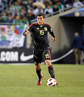 Mexico's Hector Moreno dribbles the ball.  Mexico defeated Costa Rica 4-1 at the 2011 CONCACAF Gold Cup at Soldier Field in Chicago, IL on June 12, 2011.