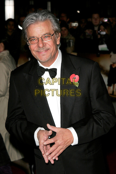"""GIANCARLO GIANNI.The Royal World Premiere of """"Quantum Of Solace"""" at the Odeon Leicester Square, London, England..October 29th 2008.James Bond half length tuxedo jacket hand finger pointing glasses poppy flower bow tie .CAP/AH.©Adam Houghton/Capital Pictures."""