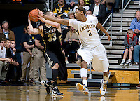 Richard Solomon of California tries to steal the ball away from Austin Dufault during the game at Haas Pavilion in Berkeley, California on January 12th, 2012.   California defeated Colorado, 57-50.