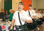 WATERBURY, CT- 3/16/01- 0316MF07.tif-(LtoR) Bobby Roland, of the Waterbury Police Pipe and Drums Corp plays as he enters<br /> during a St. Patricks Day Dinner Dance held at the Ancient Order of Hibernians Hall in Waterbury on Saturday evening, March, 16th.<br /> For Monday Focus.<br /> M. J. Fiedler Photo.
