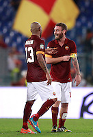 Calcio, Serie A: Roma vs ChievoVerona. Roma, stadio Olimpico, 18 ottobre 2014.<br /> Roma's Maicon, left, and Daniele De Rossi celebrate at the end of the Italian Serie A football match between Roma and ChievoVerona at Rome's Olympic stadium, 18 October 2014. Roma won 3-0.<br /> UPDATE IMAGES PRESS/Isabella Bonotto