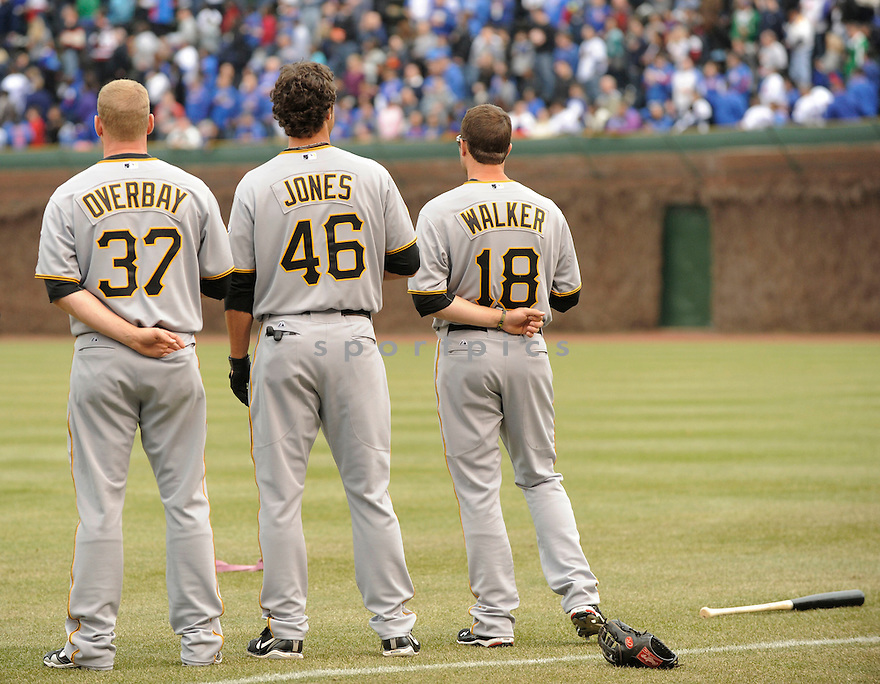 LYLE OVERBAY, NEIL WALKER, GARRETT JONES, of the Pittsburgh Pirates, in actions during the Pirates game against the Chicago Cubs at Wrigley FIeld on April 3, 2011.  The Pirates won the game beating the Cubs 5-4.