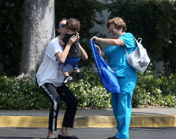 ***EXCLUSIVE*** MIAMI, FL- MAY 13 Raquel Perera, wife of Alejandro Sanz picks up their son, Dylan, at school. May 13, 2013. Mandatory Credit: KDNPIX/MediaPunch Inc.