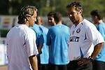 Inter Milan's Roberto Mancini head coach talks wit Sinia Mihajlovi, Assistant Coach