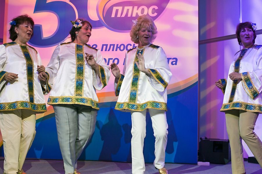 Moscow, Russia, 02/11/2011..Competitors dance onstage at the first Moscow Super-Babushka contest. A total of 105 women aged over 50 entered to compete for various titles, including most stylish, modern, elegant, business-minded, creative, artistic, and cheerful granny. The overall winning title of Super-Babushka was taken by 73 year old Ludmilla Trafinovna in the event organised by the Moscow City Government Social Welfare Department.
