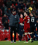 Jurgen Klopp manager of Liverpool waves to the fans with Andrew Robertson of Liverpool during the Premier League match at Anfield, Liverpool. Picture date: 30th November 2019. Picture credit should read: Simon Bellis/Sportimage