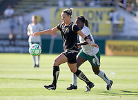 Kristen Graczyk (left) gains control of the ball, pursued by Eniola Aluko (9). St. Louis Athletica defeated FC Gold Pride 1-0 at Buck Shaw Stadium in Santa Clara, California on July 5, 2009.