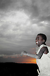 East African Rift Valley - ETHIOPIA - 15 APRIL 2004 -- An Ethiopian young boy running during sunset in the East African Rift Valley. --PHOTO: JUHA ROININEN / EUP-IMAGES