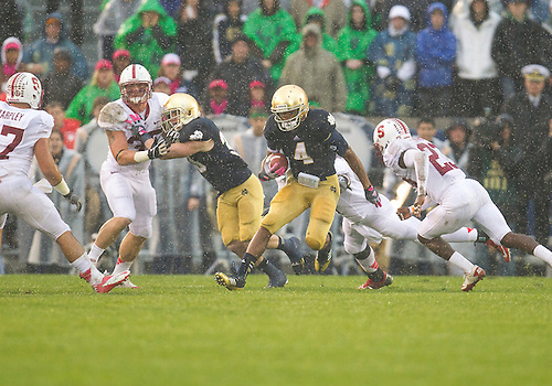 October 13, 2012:  Notre Dame running back George Atkinson III (4) runs the ball during NCAA Football game action between the Notre Dame Fighting Irish and the Stanford Cardinal at Notre Dame Stadium in South Bend, Indiana.  Notre Dame defeated Stanford 20-13.