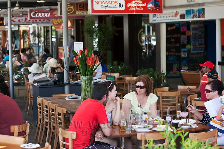 Lunchtime dining at a cafe on the Esplanade.  Cairns, Queensland, Australia