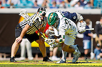 February 20, 2011:  Jacksonville Dolphins midfielder Mike Wallenhorst (25) is tripped up after a face off during Lacrosse action between the Georgetown Hoyas and Jacksonville Dolphins during the Moe's Southwest SunShine Classic played at EverBank Field in Jacksonville, Florida.  Georgetown defeated Jacksonville 14-11.