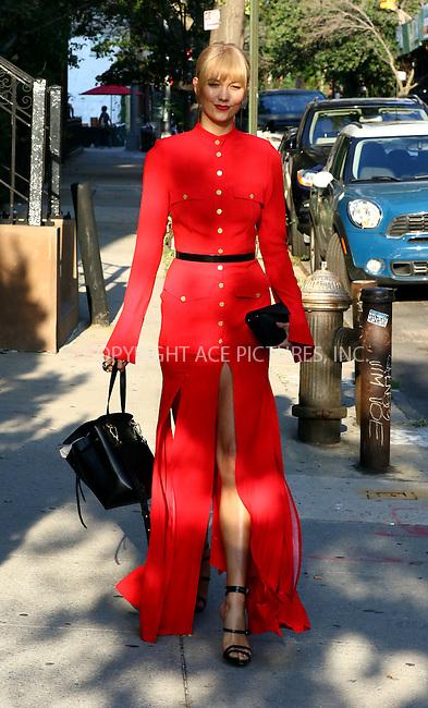 www.acepixs.com<br /> <br /> September 8 2016, New York City<br /> <br /> Model Karlie Kloss wears a red dress as she leaves her West Village apartment on September 8 2016 in New York City<br /> <br /> By Line: Zelig Shaul/ACE Pictures<br /> <br /> <br /> ACE Pictures Inc<br /> Tel: 6467670430<br /> Email: info@acepixs.com<br /> www.acepixs.com