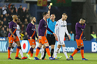Aymeric Laporte of Manchester City (C) is shown a yellow card by referee Andre Marriner during the Emirates FA Cup match between Swansea City and Manchester City at the Liberty Stadium, Swansea, Wales, UK. Saturday 16 March 2019
