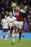 Burnley's Matthew Lowton wins the ball ahead of Tottenham's Son Heung-min during the Premier League match at the Tottenham Hotspur Stadium, London. Picture date: 7th December 2019. Picture credit should read: Paul Terry/Sportimage