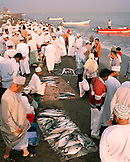 OMAN, Muscat, crowded fish market at beach