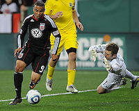 DC United forward Charlie Davies (9)  goes against Columbus Crew goalkeeper William Hesmer (1)  DC United defeated The Columbus Crew 3-1  at the home season opener, at RFK Stadium, Saturday March 19, 2011.