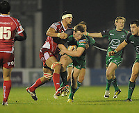 23rd November 2013; Eoin Griffen, Connacht, is tackled by Aaron Shingler, Scarlets. Rabodirect Pro12, Connacht v Scarlets, Sportsground, Galway. Picture credit: Tommy Grealy/actionshots.ie.