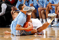 North Carolina guard Marcus Paige (5) gets tangled up with Virginia guard Justin Anderson (23) going after a loose ball during the game at the John Paul Jones arena in Charlottesville, Va.Photo/Andrew Shurtleff