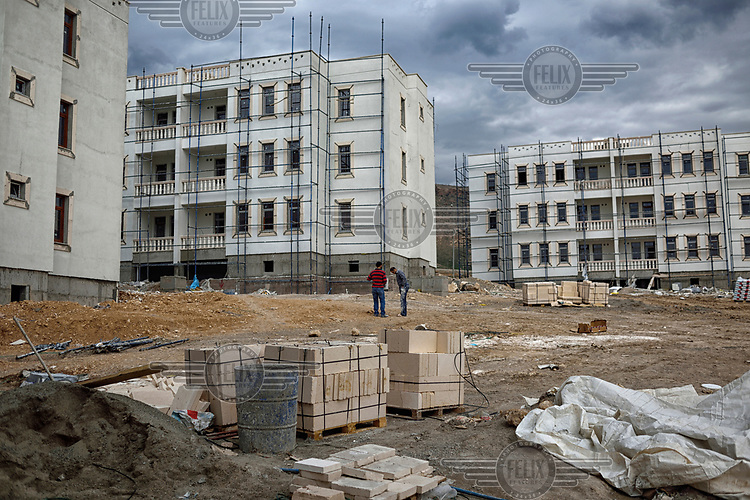 A construction site where the government is putting up new buildings to replace those which will be submerged beneath 60 metres (200 feet) of water following the completion of the Ilisu hydroelectric dam, 96 kilometres (60 miles) downstream from Hasankeyf on the Tigris River.
