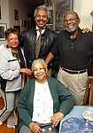 Lillian Scott, 87, of Babylon (seated in center) with (left to right) Myrna F. Taylor, 67, of Amityville, Newsday Reporter, Martin Evans, and Gene Burnett, 75, of Wheatley Heights, pose together at Burnett home in Wheatley Heights on Friday April 23, 2004. (Newsday Photo / Jim Peppler).