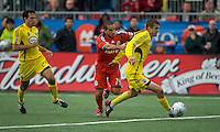 02 May 2009: Columbus Crew defender Danny O'Rourke #5 takes the ball as and Toronto FC midfielder Dewayne DeRosario #14 gives chase followed by Columbus Crew defender Jed Zayner #24 in MLS action at BMO Field in a game between the Columbus Crew and Toronto FC. .The game ended in a 1-1 draw...