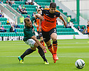 Hibs' Jordan Forster and Dundee Utd's Nadir Ciftci challenge for the ball.