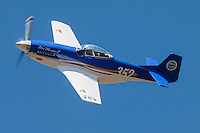 "John Parker pilots the Sport Class Thunder Mustang ""Blue Thunder"" during the 2010 Pylon Racing School"