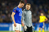 4th March 2020; King Power Stadium, Leicester, Midlands, England; English FA Cup Football, Leicester City versus Birmingham City; Jonny Evans of Leicester City grimaces as he walks off the pitch with a Leicester City physio