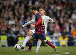 """Barcelona's Argentinian forward Lionel Messi vies with Real Madrid's Portuguese forward Cristiano Ronaldo during the """"El clasico"""" Spanish League football match Real Madrid vs Barcelona at the Santiago Bernabeu stadium in Madrid on March 23, 2014.   PHOTOCALL3000/ DP"""