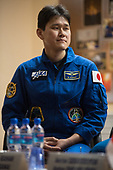 Expedition 54 flight engineer Norishige Kanai of Japan Aerospace Exploration Agency (JAXA) is seen in quarantine, behind glass, during a press conference, Saturday, December 16, 2017 at the Cosmonaut Hotel in Baikonur, Kazakhstan. Expedition 54 Soyuz Commander Anton Shkaplerov of Roscosmos, flight engineer Scott Tingle of NASA, and flight engineer Norishige Kanai of Japan Aerospace Exploration Agency (JAXA) are scheduled to launch to the International Space Station aboard the Soyuz spacecraft from the Baikonur Cosmodrome on December 17.  <br /> Mandatory Credit: Joel Kowsky / NASA via CNP