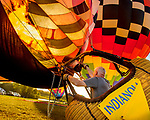 A near record crowd hot air balloon fans filled the hillsides at the National Balloon Classic launch field July 29 for opening ceremonies, balloon launches and music. A balloonist sends a blast of heat and fire into his balloon.