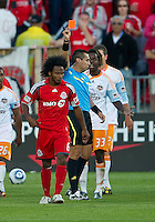 01 July 2010:  Houston Dynamo forward Joseph Ngwenya #33 and Toronto FC midfielder Julian de Guzman #6 both receive a red card from referee Jair Marrufo for violent conduct during a game between the Houston Dynamo and the Toronto FC at BMO Field in Toronto..Final score was 1-1....