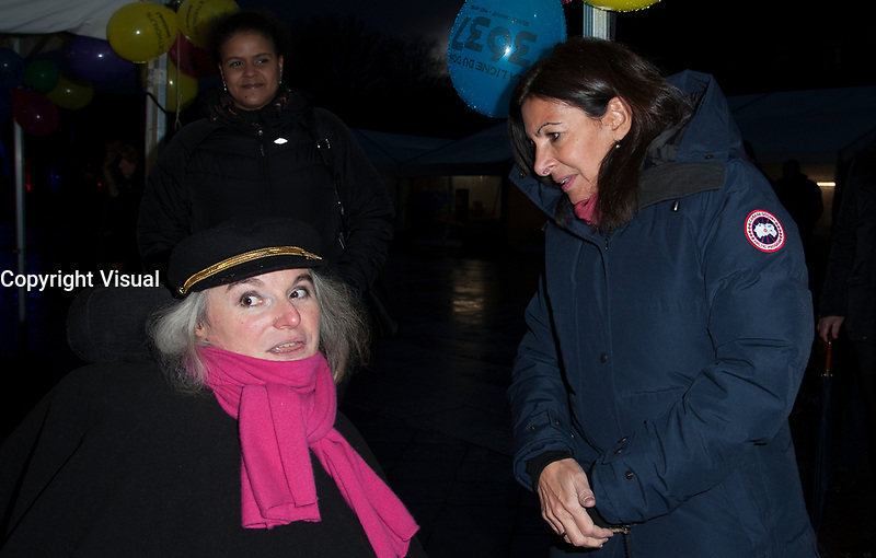 December 8 2017, PARIS FRANCE<br /> The Mayor of Paris Anne Hidalgo and her<br /> Assistants visit the Telethon Village 2017<br /> to meet the Afm Association at Hotel de Ville Paris.