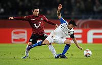 FUSSBALL   EUROPA LEAGUE   SAISON 2011/2012  SECHZEHNTELFINALE Hannover 96 - FC Bruegge                                    16.02.2012 Manuel Schmiedebach (Hannover 96) gegen  Lior Refaelov (re, Bruegge)