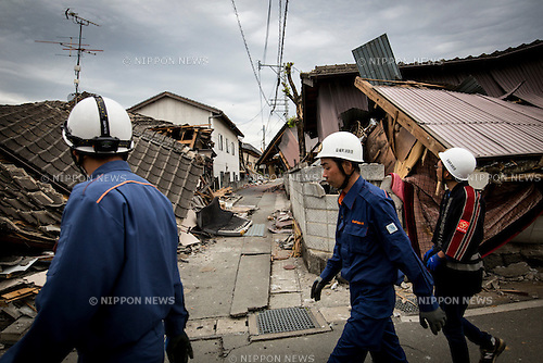 KUMAMOTO, JAPAN - APRIL 16: A group of firemen patrolling to check the houses in the streets of Mashiki, Kamimashi-Gun, Kumamoto Prefecture, Japan. The area was severely hit by a magnitude-6.5 quake Thursday night and followed by magnitude-7.3 quake on Saturday early morning on April 16, 2016 in Kumamoto prefecture, Japan.(Photo by Richard A. de Guzman/AFLO)
