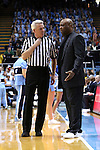 24 January 2015: Florida State head coach Leonard Hamilton (right) argues with referee Brian O'Connell (left). The University of North Carolina Tar Heels played the Florida State University Seminoles in an NCAA Division I Men's basketball game at the Dean E. Smith Center in Chapel Hill, North Carolina. UNC won the game 78-74.