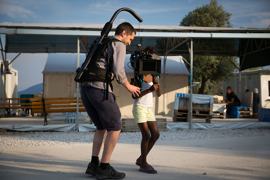 Cameraman Will Hanke with a refugee child at Kara Tepe site on the Greek island of Lesvos.