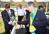 Harold Mayne-Nicholls receives a gift when leaving George Mason soccer stadium during the visit of the FIFA World Cup 2018-2022 inspection delegation to George Mason University soccer practice facility.