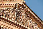Statues on the facade of the National Library, founded by King Philip V in 1712 in Madrid