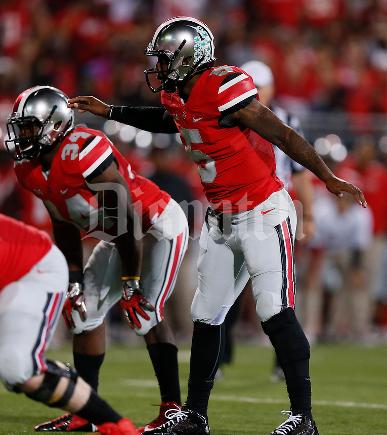 Ohio State Buckeyes quarterback Braxton Miller (5) calls a play in the third quarter of Saturday's NCAA Division I football game against Wisconsin at Ohio Stadium in Columbus on September 28, 2013. (Barbara J. Perenic/Columbus Dispatch)