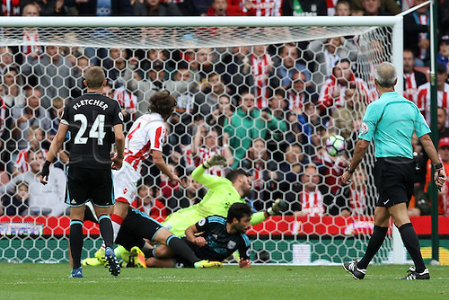24.09.2016. Bet365 Stadium, Stoke, England. Premier League Football. Stoke City versus West Bromwich Albion. Joe Allen of Stoke City beats Ben Foster of West Bromwich Albion at close range to give Stoke a 1-0 lead.