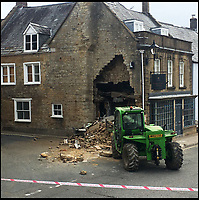 BNPS.co.uk (01202 558833)<br /> Pic: LouiseChidgey/Brassica/BNPS<br /> <br /> Epic Fail...<br /> <br /> Inept ram raiders have demolished half the wall of a furniture showroom in the sleepy Dorset town of Beaminster last night.<br /> <br /> The cash machine is still to be leived to be in the rubble and the theives were forced to abandon the tractor used in the raid.