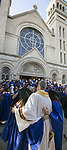 Students pose for photos with the Rev. Dennis H. Holtschneider, C.M., president of DePaul University, outside the Saint Vincent de Paul Parish Church on DePaul University's Lincoln Park Campus Friday, June 9, 2017, following the annual Baccalaureate Mass. The event was part of the 119th commencement ceremonies for the Chicago university. (DePaul University/Jamie Moncrief)